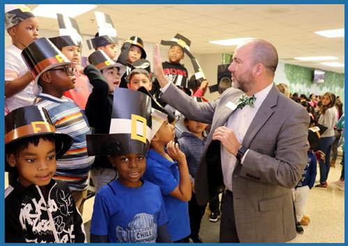 incipal for a Day Adam Forrand of Partnership Gwinnett congratulates Peachtree ES kindergarten students on their Thanksgiving