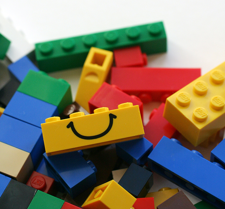 LEGO blocks with a smiling block