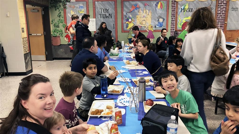 Students and parents enjoy lunch at the winter luncheon.