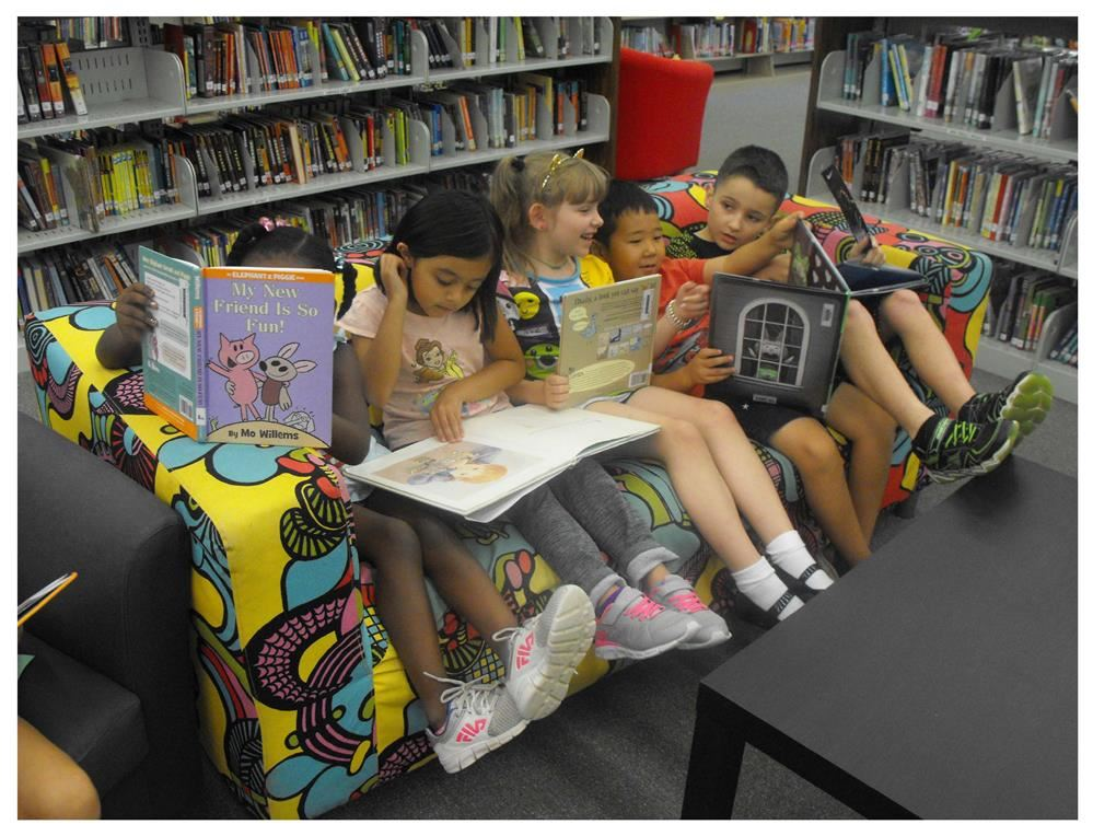 Students reading in the media center