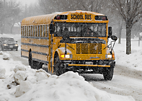 An image of a bus driving in inclement weather