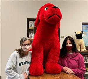 two women with clifford the big red dog
