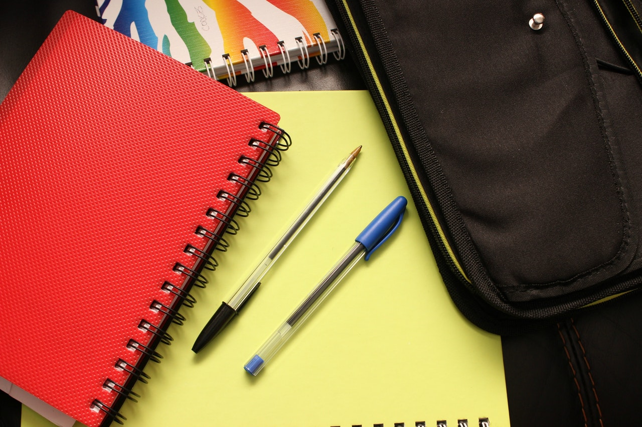 Binder, pencil, and blank notebook