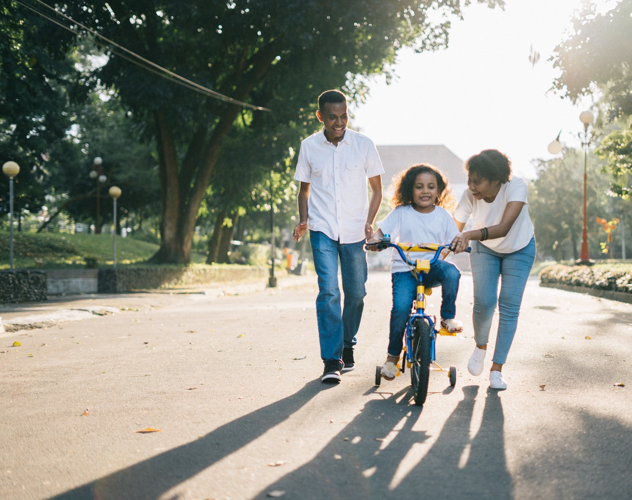 mother, father, and child on bicycle
