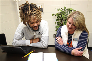 Jennifer Tennant works with a Graduate Gwinnett student.