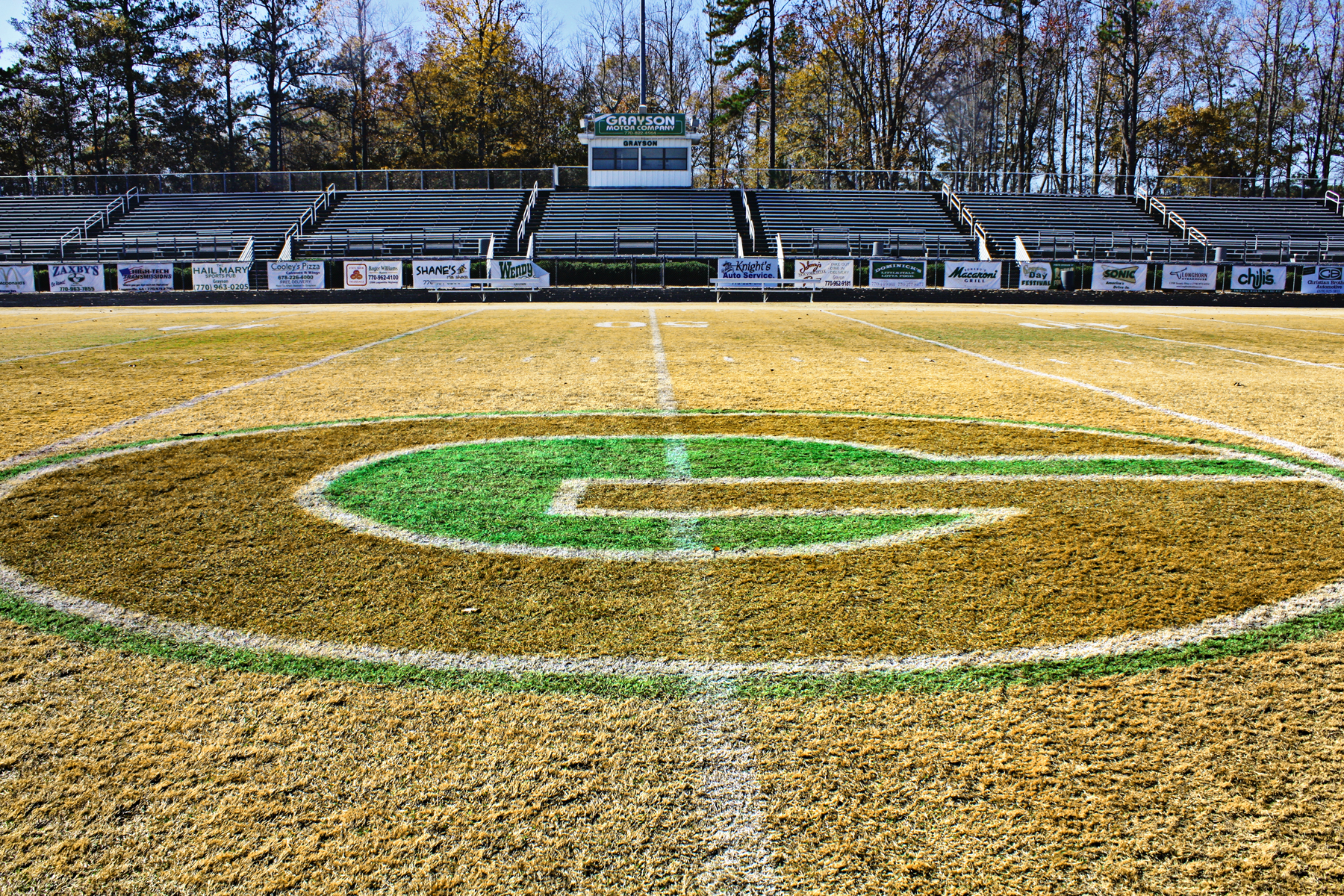 "Football field with ""G"" painted on it."