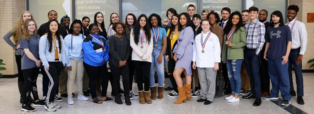 Skills USA students wearing the medals they received at a competition