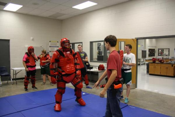 Students learning self defense techniques
