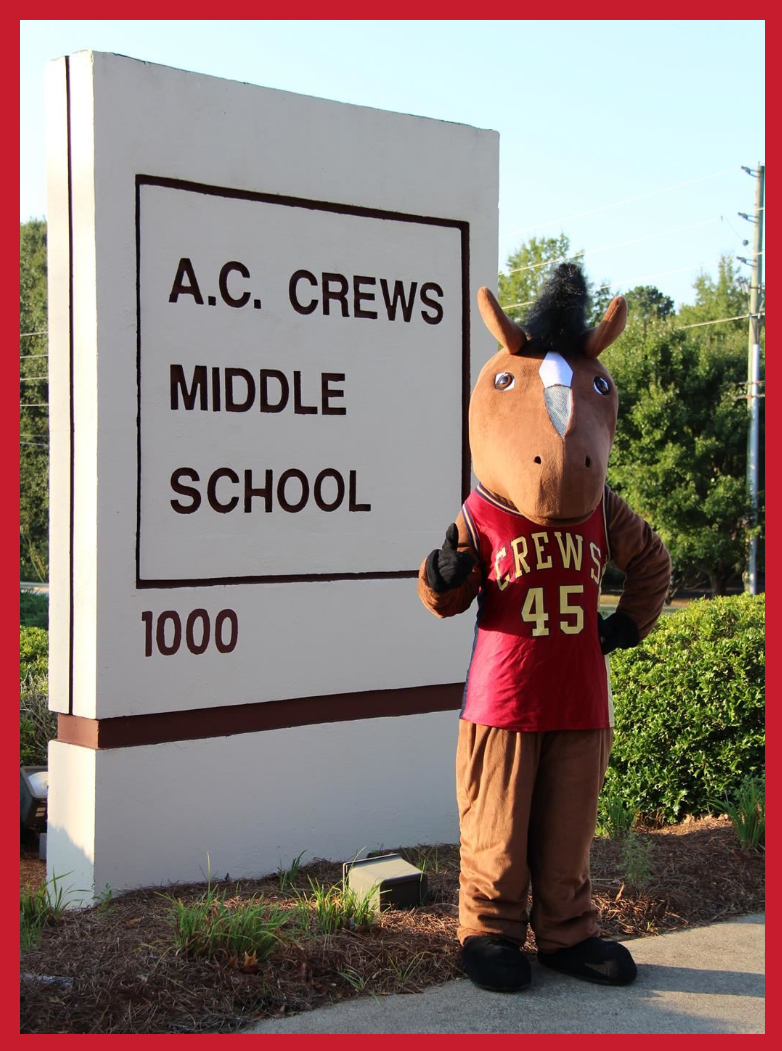 Mascot with school sign